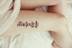 "Om Mani Padme Hum -- The Tibetan Buddhist mantra of compassion: ""Praise to the jewel in the lotus"". Instead of the actual lotus? Maybe in Hindi?"