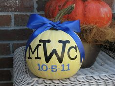 do a monogram pumpkin with due date?  the pumpkins at (michaels/any craft store) that you can carve or paint on