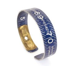 This handmade round bangle is crafted from a vintage Globe Master fold-out ruler. It is made from the end piece and is special because it carries the