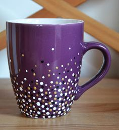 """Good hack for the spitty tendencies of paint markers: """"make a little puddle on a piece of paper by clicking the pen a couple of times, and then use the pen as a brush. Just dunk the pen in it, and make a little dot on the mug. It's pretty easy. I started with white, then did the golden dots, and finally the black ones."""""""