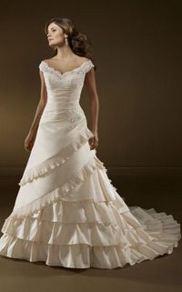 I love the top and back not so much of the bottom...Country Wedding Dress #1