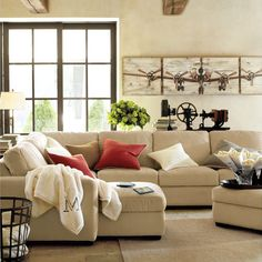 the ultimate sofa from pottery barn - build it yourself sectional including a recliner and chaise option.  love the black and tan living room, very restoration hardware of them :)