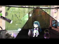 """HAKO-ANI (Box Sister) is a holographic display designed for use with iPad and other tablet devices. It allows users to enjoy 3D images projected from their tablet to a pyramid shaped holographic display. This means fans of virtual idols, such as Hatsune Miku can use it to enjoy tiny """"live"""" performances from the comfort of their home. The tablet version of HAKO-ANI will be available on August 1st and will cost ¥36,750 ($467 US)."""