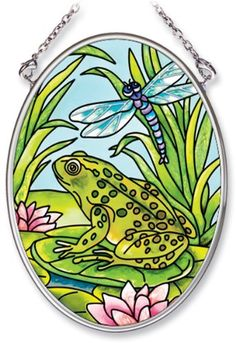 Amia Hand Painted Glass Suncatcher with Frog and Dragonfly Design, 3-1/4-Inch by 4-1/4-Inch Oval by Amia. $11.00. Comes boxed, makes for a great gift. Handpainted glass. Includes chain. Amia glass is a top selling line of handpainted glass decor. Known for tying in rich colors and excellent designs, Amia has a full line of handpainted glass pieces to satisfy your decor needs. Items in the line range from suncatchers, window decor panels, vases, votives and much more.