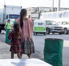 Mother & daughter walking the streets of Fronteras, Rio Dulce, Guatemala.  | mjsailing.com | Sailing blog