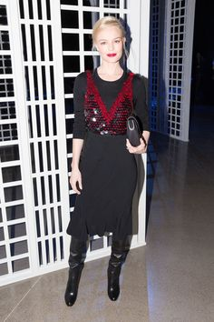 Kate Bosworth layers a pailette crop top over a sleek black dress with over-the-knee boots