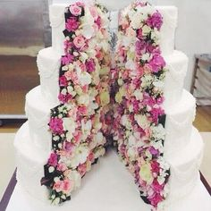 fun and colorful wedding cake, inside out cake with flowers inside cake