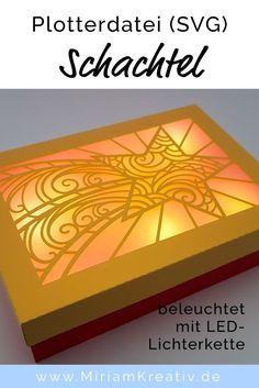 """Bastele eine wunderschöne beleuchtete Schachtel als Verpackung für ein Geschenk oder als Deko mit der kostenlosen Plotterdatei """"Schachtel""""(SVG - Freebie) und wähle aus vielen unterschiedlichen Motiven zur individuellen Gestaltung des Deckels..."""