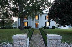 Houzz.....beautiful old farmhouse, restored. In Tennessee. More beautiful outside than inside. I would restore this home, inside, to reflect the integrity and style of the house.