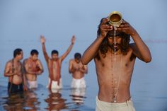 Men prayed as they bathed at Sangam, the confluence of the Ganges, Yamuna and mythical Sarasvati rivers, during the Kumbh Mela Hindu pilgrimage in Allahabad, India, Sunday. (Roberto Schmidt/Agence France-Presse/Getty Images)