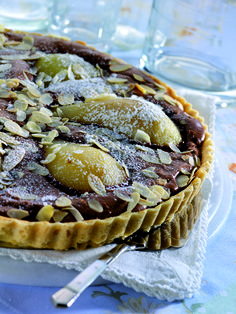 French chef Escoffier combined #pears and #chocolate to make a famous dessert, poires Belle Helene. This wonderful tart reunites those flavors.
