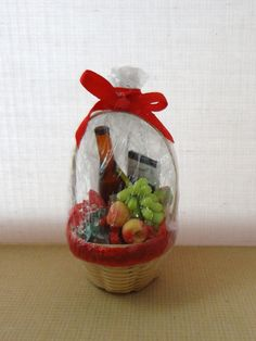 SALE / RESERVED 1:12 dollhouse miniature gift basket with wine fruits cookies and chocolate also as ornament. $10.00, via Etsy.