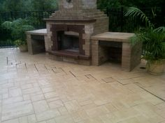 Add a pavingstone woodbox to your outdoor fireplace. Outdoor living Cambridge Pavers style.
