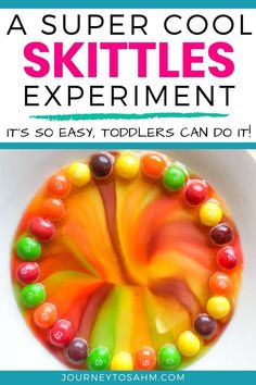 This easy science experiment is done with Skittles to create a rainbow! Enjoy these cool ideas to make this project even more fun. Geared for toddlers ages 2 and up. #toddleractivities #activitiesforkids