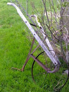 A very old plow that would have been pulled by a horse, donkey, or steer to break up the ground.