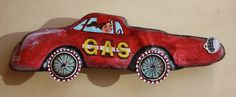 'Gas' by Ginny Rose. Acrylic on driftwood with mixed media.