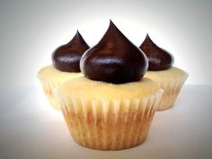 Introducing our Eclair Cupcake - Vanilla cake filled with French vanilla cream and topped with a dark chocolate ganache