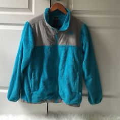 Blue Fuzzy Northface Kids extra large. Fits a women's small loosely or a medium perfectly. Has some light brown spots around right pocket hence the price. Around the zipper the blue fuzz has some wear. Good condition for being used other then that. Reposh because I got another one :) FEEL FREE TO MAKE AN OFFER North Face Jackets & Coats