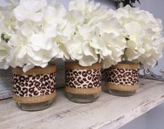 What a great idea.Set of 3 Burlap and Leopard Print Ribbon Wrapped Mason Jars. Perfect for Gifts, Home Decorations, Weddings, Storage, and Cheetah Birthday, Leopard Print Party, Animal Print Party, Animal Print Decor, Cheetah Print, Animal Print Wedding, Leopard Prints, Safari Party, Safari Theme