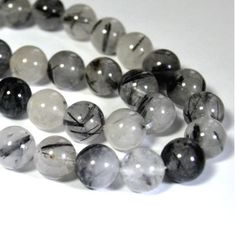 Tourmalated Quartz Round Beads - 10 count - This super lucky stone has the luck of both the quartz and tourmaline. The luck in this stone is very strong. Many use it by rubbing it when powerful luck is needed.