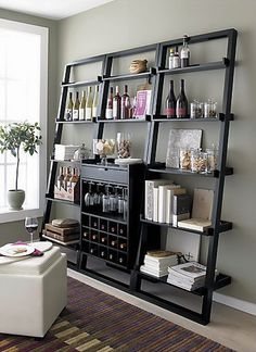 a book case and wine bar in one <3 ...two of my favs in one!