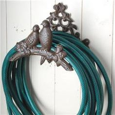 Bird Decorative Hose Holder! I could... yeah, I want this for my house in the future!