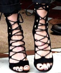 Cara wears a pair of lace-up suede sandals from Alexandre Vauthier's Fall 2016 Haute Couture collection