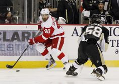 CrowdCam Hot Shot: Detroit Red Wings center Henrik Zetterberg carries the puck up ice against Pittsburgh Penguins defenseman Kris Letang during the first period at the CONSOL Energy Center. The Detroit Red Wings won 4-1. Photo by Charles LeClaire