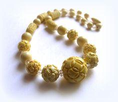 Vintage Carved celluloid necklace. $32.00, via Etsy.