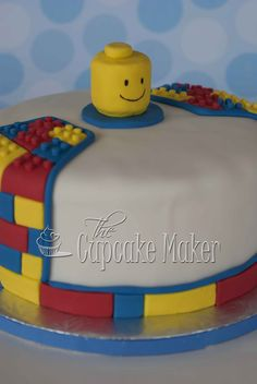 Chocolate cake filled with chocolate buttercream and covered with fondant. Lego pieces and Lego man head made out of fondant.