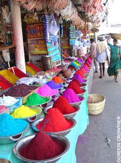 Dishes of spice and dye in a vibrant street market in India