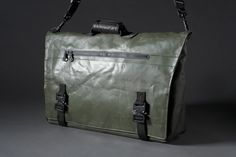 Water tight tarpaulin bag with a sweet crumpled up vintage look.