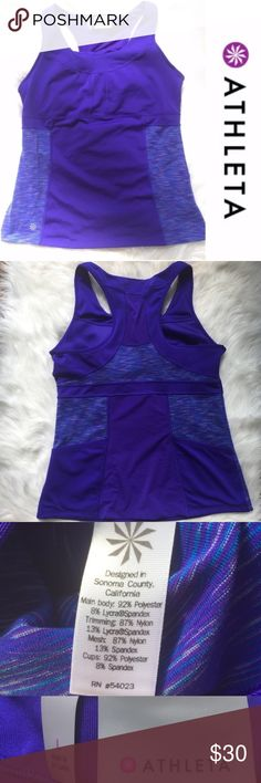 Athleta Racerback Yoga Support Pad Tank Top Large Women's Athleta Racerback Athletic Activewear Tank Top Built in shelf bra Great for exercising or yoga 2 back pockets Stretchy and durable Wicking print Raacerback with a mesh insets Color: purple, gray, and blue Gently used condition with no stains or holes.  Size: large Please see pictures for fabric content and approximately measurements flatlay, relaxed.  Feel free to make an offer or bundle & save!  ab26 919021118 Athleta Tops Tank Tops