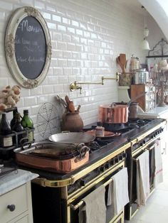 Unbelievable kitchen.  Copper, brass, marble and the creature comforts any designing chef would expect