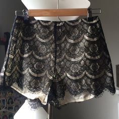 Lush black lace on ivory silk shorts Lined with silly polyester. Pair with a crop top and shake your tail feathers Lush Shorts