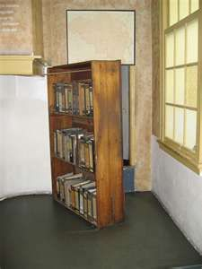The swinging bookcase that covered the entrance to the Frank's hiding place, known as the Secret Annex.