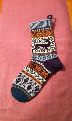 Christmas- stocking in untraditional colours. Pattern free on ravelry.