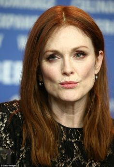 Flawless: With her flamed-coloured tresses left loose in sleek waves, Julianne enhanced he...