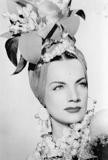 Carmen Miranda, (February 9, 1909 – August 5,1955) was a Portuguese-born Brazilian samba singer, Broadway actress and Hollywood film star popular in the 1940s and 1950s. She was, by some accounts, the highest-earning woman in the United States and noted for her signature fruit hat outfit she wore in the 1943 movie The Gang's All Here. Though hailed as a talented performer, her movie roles in the United States soon became cartoonish and she grew to resent them. Died of a heart attack age 46.