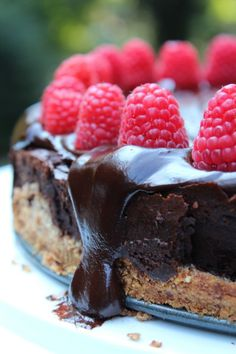 Decadent Dark Chocolate Cheesecake with an Almond Crust; topped with fresh Raspberries