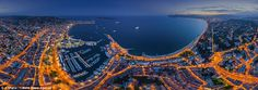 In this image of Cannes, you can see the yachts breaking the calm waters while its roads are flooded with light like veins of the city
