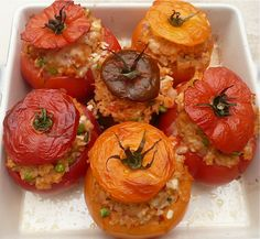 Is it art or is it dinner? Baked  Tomatoes Stuffed with Rice. Looking forward to the left overs for lunch.