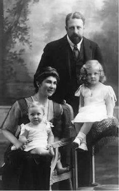 Their Imperial and Royal Highnesses Prince and Princess Pedro de Alcântara of Orléans and Braganza, Prince and Princess of Grão Para, with Prince Pedro Gastão (1913–2007), on his mother's lap, and Princess Isabelle (1911–2003) of Orléans-Braganza