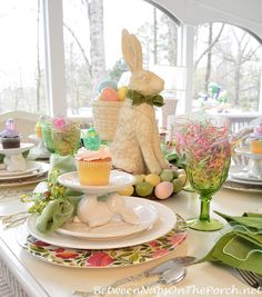 A Spring Table Setting with the Easter Bunny -- Love the bunny cupcake stand.