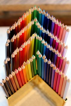 stylish gift idea # 26: vibrant colored pencils in brass pencil holder. $75.