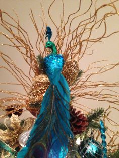 A peacock Christmas tree topper  Alyse - do you see this??