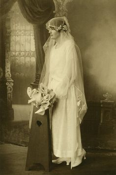 Bride profile in pew by Lilly's Lace, via Flickr