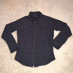 Lululemon Track Jacket Like new! No stains, pulls or pilling. Worn a few times. Thick and stretchy material. Tag partially torn, my best guess is that it's a size 6. Fits an XS/S. Pockets zipper also. Length=24.5 inches, waist=16.5 inches, bust=18.5 inches. Waist taken at top of pockets, bust taken at the bottom of where the sleeve starts. Make an offer! lululemon athletica Jackets & Coats