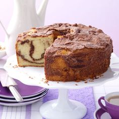Cinnamon Coffee Cake Recipe -I love the excellent texture of this old-fashioned streusel-topped coffee cake. Always a crowd-pleaser, its pleasing vanilla flavor enriched by sour cream may remind you of breakfast at Grandma's! —Eleanor Harris, Cape Coral, Florida **