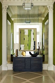 Mirror Wall & Green Velvet in hallway design ideas on HOUSE - design, food and travel by House & Garden. Opulent hallway with floor to ceiling mirror glass reflecting two walls of emerald-coloured velvet.